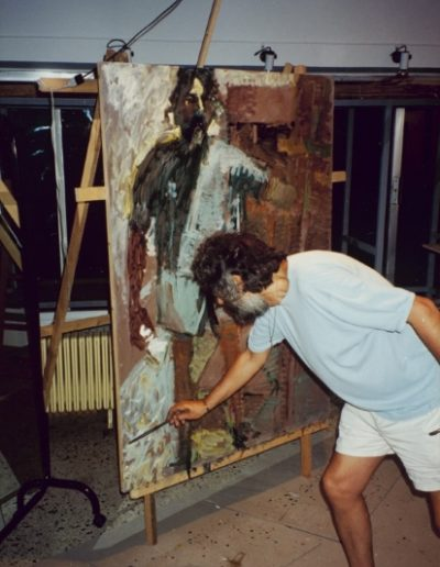 Painting a self-portrait at his atelier in Fleming Street, Thessaloniki, 1993